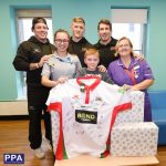 Dan Mugford of Plymouth Albion, Sam Daly of Plymouth Albion, Eoghan Grace of Plymouth Albion, Front row L/R Holly Williams Harrison Levy age 11 and Anita Dykes, Players from   Plymouth Albion Visit young children in Derriford Hospital, Plymouth, Devon on December 5, - PHOTO: Sean Hernon/PPAUK